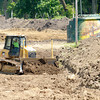 Don Knight/The Herald Bulletin<br /> Construction continues on the levee at Edgewater Park in Anderson. Those working outside are dealing with 90 degree heat this week.