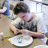 Don Knight/The Herald Bulletin<br /> Iain Ficher creates beads for a bracelet during Central Christian Church's arts camp.