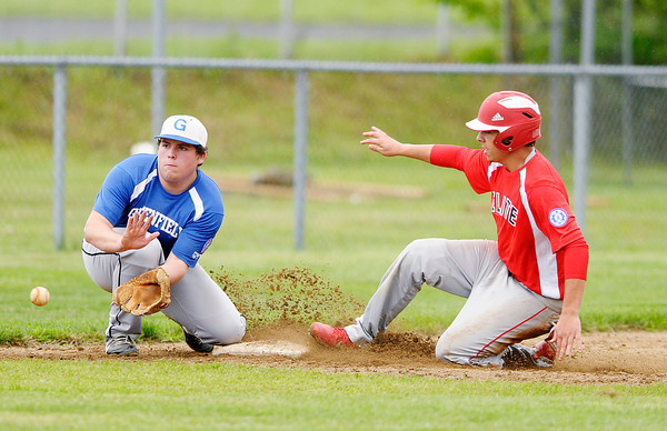 Don Knight/The Herald Bulletin<br /> Madison County Elite's Tony Bova steals third as the Elite defeated Greenfield to advance to the semi-final during the Babe Ruth state tournament at Memorial Field on Saturday.