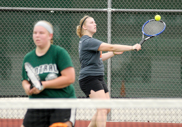 Don Knight/The Herald Bulletin<br /> Alex Hammel returned a volley as she played with her sister Michaela against mother daughter team Dru and Katie McCoy during a Women's A Doubles match on the first day of the Community Hospital Anderson Tennis Classic at Anderson University on Saturday.