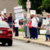 A group of seniors demonstrated along 8th Street in front of the city building Tuesday protesting the proposed changes to their Social Security benefits.