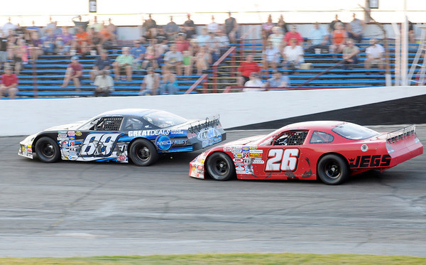 Don Knight/The Herald Bulletin<br /> Trent Snyder passes Bubba Pollard for the lead following a restart during the JEGS/CRA All-Stars Tour 100 lap race at the Anderson Speedway on Friday. Snyder went on to win the race