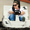 Tina Fisher smiles as she gets closer to one of her family members as they race go-carts Monday afternoon at Applewood Raceway at 1819 E. 60th Street in Anderson.  The Fishers, who live in Redkey, Ind., were coming home from Indianapolis and decided to stop and have a little family fun.