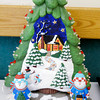 Don Knight/The Herald Bulletin<br /> This ceramic holiday piece by Katelynn Gossage won a Grand Champion ribbon. Projects will be on display for viewing in the Exhibit Hall during the 4-H Fair.