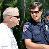 Stu Hirsch/The Herald Bulletin<br /> Clyde Looper, 80, talks with an APD officer as his truck is recovered from Shadyside Lake on Wednesday.