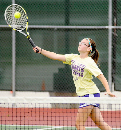 Don Knight/The Herald Bulletin<br /> Katie McCoy returns a volley as Katie and her mother Dru faced sisters Alex and Michaela Hammel in a Women's A Doubles match during the first day of the Community Hospital Anderson Tennis Classic at Anderson University on Saturday.