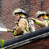 Firefighters battled a blaze in a house at 910 Main Street in Lapel Wednesday afternoon.  Firefighters fought the fire from the roof of the business next door to help contain the blaze.