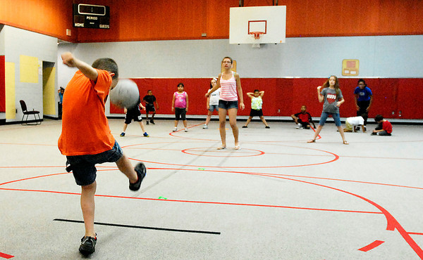 Impact Center's mini-camp for kids gives children a place to go and helps keep them busy with lots of activities like kickball.