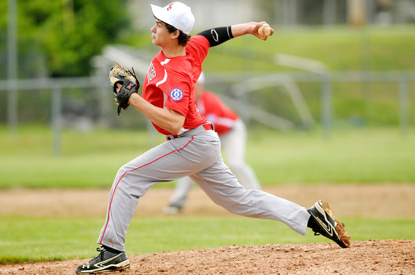 Don Knight/The Herald Bulletin<br /> Caleb York pitches for the Madison County Elite as they defeated Greenfield to advance to the semi-final during the Babe Ruth state tournament at Memorial Field on Saturday.