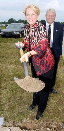 Myers Autoworld president Mary Jamerson holds up a shovel full of dirt at the groundbreaking celebration for their new Ford and Buick-GMC dealership to be constructed in the 2900 block of South Scatterfield Road in Anderson.