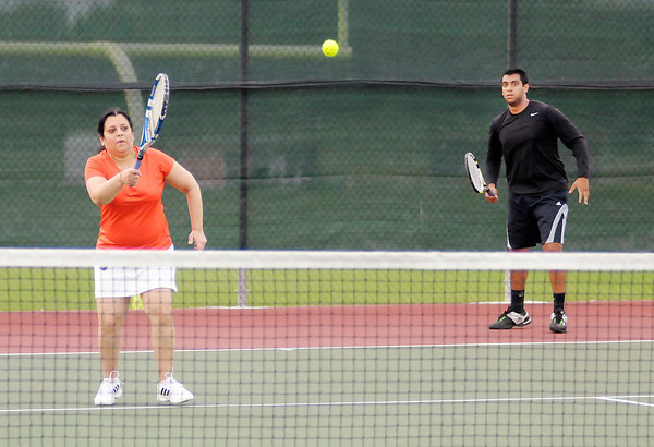 Don Knight/The Herald Bulletin<br /> Alpa Patel returns a volley as Alpa and her son Rishi play Terry and Jay Day in a Mother-Son Doubles match on the first day of the Community Hospital Anderson Tennis Classic at Anderson University on Saturday.