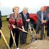 As others watch Myers Autoworld president Mary Jamerson turns a second shovel full of dirt over at the groundbreaking for their new Ford and Buick-GMC dealership buildings in the 2900 block of South Scatterfield Road in Anderson.