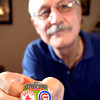Monty Porter shows off his favorite baseball pin, The Cubs at Fenway Park against the Boston Red Sox from 2011.