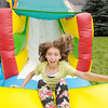 Don Knight/The Herald Bulletin<br /> Brianna Savage 13 tumbles down a bounce house slide during New Horizons United Methodist Church's People and Pets Extravaganza on Saturday.