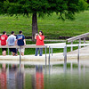Kelly Hughes, of Anderson, takes a family portrait of her four children at the pond at Pulaski Park Tuesday afternoon. The kids are Kile, 16; Zac, 15; Aubree, 12; and Ryan, 6.