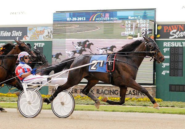 Don Knight/The Herald Bulletin<br /> Lewayne Miller drives Andi's Elana to the win the first race during Hoosier Park's Night of Champions on Saturday.