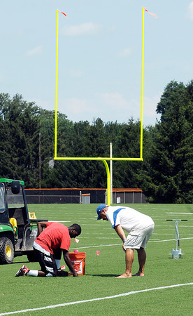 Ground keepers work on the Colts' practice fields Tuesday in preparation for the start of Colts training camp this weekend.