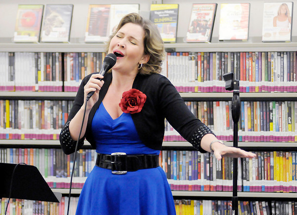 "Don Knight/The Herald Bulletin<br /> Anita Hall performs a community concert at the Alexandria-Monroe Public Library on Friday. Anita performed the title track from her latest album ""Send Love"" during the free concert."