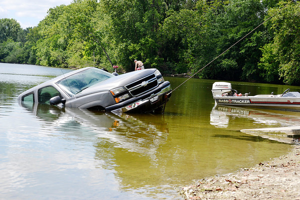 Stu Hirsch/The Herald Bulletin<br /> Anderson Wrecker Service recovers a Chevrolet Silverado from Shadyside Lake on Wednesday. Clyde Looper, 80, was launching his Bass Tracker for a day of fishing when the boat, still strapped to the trailer, pulled his truck into the lake. Passers by helped Looper escape the cab of the truck.