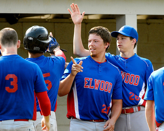 Elwood's Bryce Groves is congratulated by teammates C.J. Sanqunetti and Matt Manship after scoring in their game with Madison County Elite.