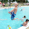 Don Knight/The Herald Bulletin<br /> Teagan Lundy, 10, jumps into the Alexandria pool on Tuesday. With temperatures forecast to be in the 90s this week many people sought refuge from the heat with a dip in the pool.