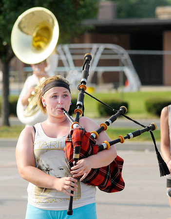 Don Knight/The Herald Bulletin<br /> Kassi Olive, 17, practices with he Anderson High School marching band  Thursday evening. The band will be competing this Saturday in the Muncie Southside High School Spirit of Sound contest.