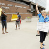 "Don Knight/The Herald Bulletin<br /> The group Friends of Trayvon wave at a passing motorist who honked in support as the group protested ""Stand Your Ground"" laws outside the Madison County Government Center on Saturday."