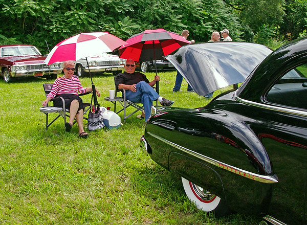 Mark Maynard  | for The Herald Bulletin<br /> New Castle residents Julie and John Melton relax behind their fully restored 1950 Oldsmobile Rocket 88 during the 12th Annual Bill Vaughn Memorial Cruise-In at Frisch's.