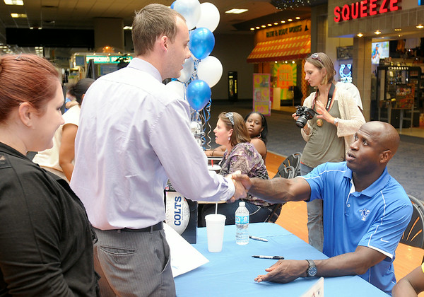 Don Knight | The Herald Bulletin<br /> Former Colt Marlin Jackson meets fans and signs autographs at the Mounds Mall on Saturday. Jackson was in town to promote the silent auction of two Harley Davidson motorcycles that will be part of this year's Rockin' the Runway event at Hoosier Park. This year's event will benefit Jackson's Fight for Life Foundation.