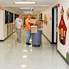 Bob Ours, left, and Andy Davis move empty boxes to a larger trash<br /> bin Tuesday as they ready Elwood Elementary School for arriving students<br /> today. <br /> To view or buy this photo and other Herald Bulletin photos, visit<br /> photos.heraldbulletin.com.