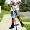 John P. Cleary | The Herald Bulletin<br /> Tamarje' English, 6, bounces high as he jumps around on his Pogo stick along the 1600 block of West 15th Street Monday afternoon.  To view or buy this photo and other Herald Bulletin photos, visit<br /> photos.heraldbulletin.com.