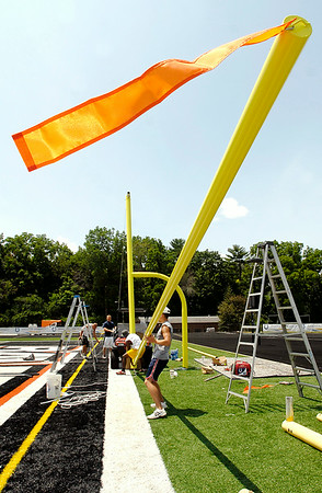 John P. Cleary | The Herald Bulletin<br /> Crews were busy installing new goalposts at Macholtz Stadium on the Anderson University campus Thursday in preparation for the start of Colts Camp next week. The NFL changed the rules and increased the height of the goalposts by five feet requiring all new posts for the training camp. After camp is over the goals in the stadium will be changed back to the old ones to match collegiate standards. <br /> To view or buy this photo and other Herald Bulletin photos, visit<br /> photos.heraldbulletin.com.