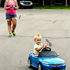 John P. Cleary | The Herald Bulletin<br /> Tinzley Spall, who just turned 1 year old Thursday, claps as she enjoys a ride down Falls Ct. in her new remote controlled sports car she received as a birthday gift from her grandfather.  Operating the controls  of the BMW convertible is Tinzleys mother Shalee Spall.  To view or buy this photo and other Herald Bulletin photos, visit<br /> photos.heraldbulletin.com.