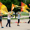 John P. Cleary | The Herald Bulletin<br /> These members of the Anderson High School Marching Band flag corps were having a hard time controlling their flags due to the stiff northwest wind that was blowing Tuesday afternoon.
