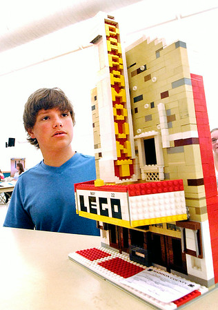 John P. Cleary | The Herald Bulletin<br /> Trey Campbell, 14, of the Creation Corner 4-H Club, explains to the Construction Toys projects judge, Tanya Wirtz, how he made his project of a replica of the Paramount Theatre out of legos.  Campbell won a Grand Champion ribbon with his model.  To view or buy this photo and other Herald Bulletin photos, visit<br /> photos.heraldbulletin.com.