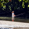 John P. Cleary | The Herald Bulletin<br /> Mounds State Park's Junior Naturalists Day Camp participants enjoy fishing along White River as part of their camp activities.