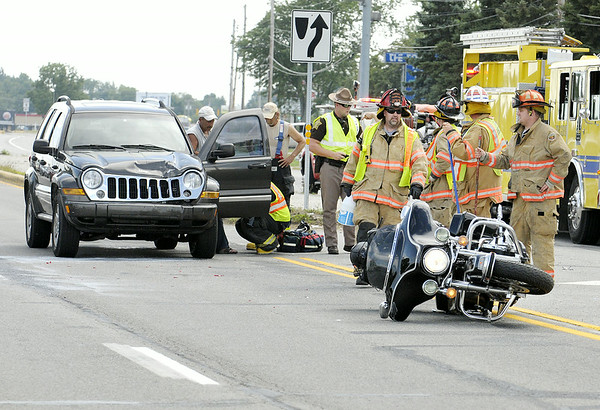 Don Knight | The Herald Bulletin<br /> An accident between a Jeep and motorcycle in the 3000 block of north Ind. 9 injured the driver and passenger of the motorcycle and closed northbound traffic Sunday afternoon.