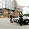 John P. Cleary   The Herald Bulletin<br /> Madison County and Anderson police block the streets around the Madison County Government Center Monday afternoon after receiving a bomb threat and evacuating the building.