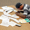 John P. Cleary | The Herald Bulletin<br /> Cartoonist Deon Parsons works in the Anderson Public Library.
