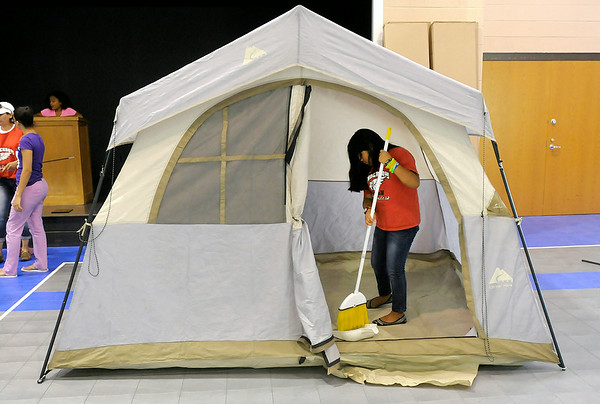 Don Knight | The Herald Bulletin<br /> Jeimy Bautista, 12, sweeps out a tent as the Pathfinders at Cross Street Christian School prepare for a trip to Oshkosh Wisconson.  To view or buy this photo and other Herald Bulletin photos, visit photos.heraldbulletin.com.