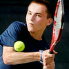 John P. Cleary | The Herald Bulletin<br /> Matt Tran eyes the ball as he hits a backhand during his Men's A Singles match against Kassidy Kase Wednesday evening in the Anderson Tennis Classic.