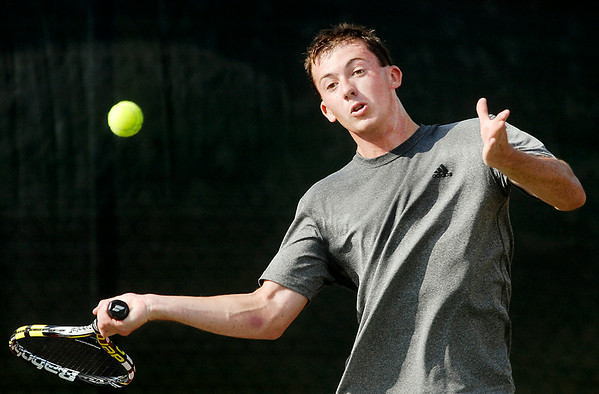 John P. Cleary | The Herald Bulletin<br /> Kassidy Kase hits a forehand during his Men's A Singles match against Matt Tran Wednesday evening in the Anderson Tennis Classic.
