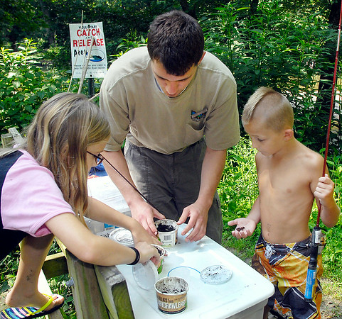 John P. Cleary | The Herald Bulletin<br /> Danny Waters, interpretive intern at Mounds State Park, gets out fishing bait for the junior naturalists day camp participants.