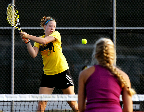 John P. Cleary | The Herald Bulletin<br /> Dana Huck hits a backhand toward Sidnay Huck during their semifinal mixed A doubles match Friday evening at the Anderson Tennis Classic.<br /> To view or buy this photo and other Herald Bulletin photos, visit<br /> photos.heraldbulletin.com.