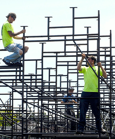John P. Cleary | The Herald Bulletin<br /> Workers for Nussli U.S., out of Indianapolis, put together the framework of the bleachers being installed along the practice field at Anderson University for Colts Camp.  According to AU there will be about 2,000 bleacher seats for this years camp. <br /> To view or buy this photo and other Herald Bulletin photos, visit<br /> photos.heraldbulletin.com.