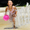 John P. Cleary | The Herald Bulletin<br /> Layla Murray, 6, of Anderson, keeps her eyes closed tight as she runs through one of the water sprays at the Middletown Water Park Tuesday afternoon as she kept cool on a hot, sunny afternoon.