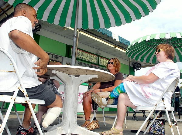 """John P. Cleary   The Herald Bulletin<br /> Amputees Mingo Vontress, Kelly Haynes, and Kim Ousley talk to each other during the 2nd annual """"Show Your Mettle"""" event held at Frazer's Dairy Maid last week.  The event was a meet & greet to help support limb loss awareness."""