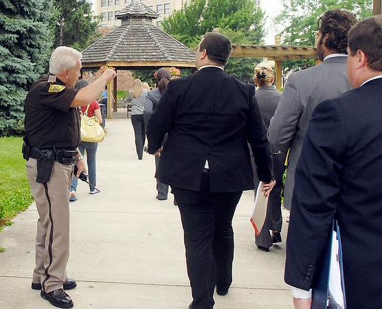 John P. Cleary   The Herald Bulletin<br /> Madison County Sheriffs deputies assist with the evacuation of the Madison County Government Center Monday afternoon after receiving a bomb threat.