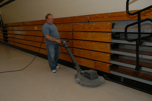 DSC_0005: Jeff McDaniel, a long-time custodian at Elwood Elementary School<br /> buffs the gymnasium floor Tuesday as staff prepared for school, which<br /> begins today.