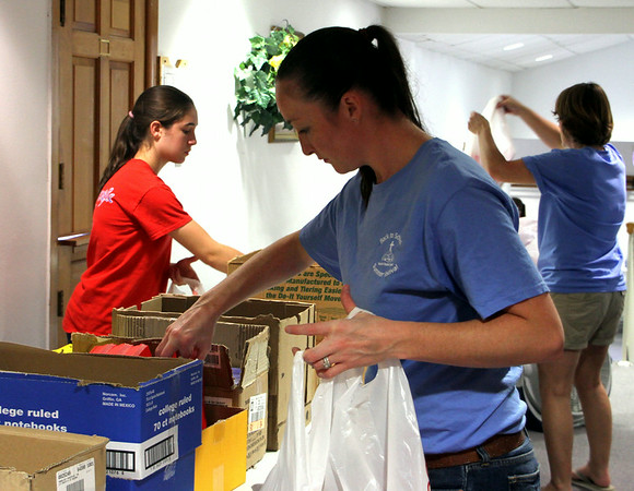Chris Martin for THB<br /> Volunteers gather supplies at the school supply giveaway sponsored by the Anderson Parks Department held at Mounds Baptist Church Sunday